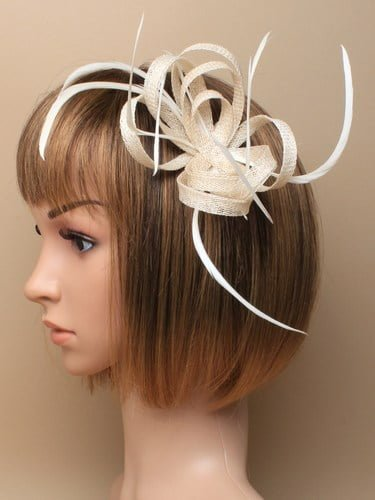 Ivory fascinator with loops and feathers on clip and pin.
