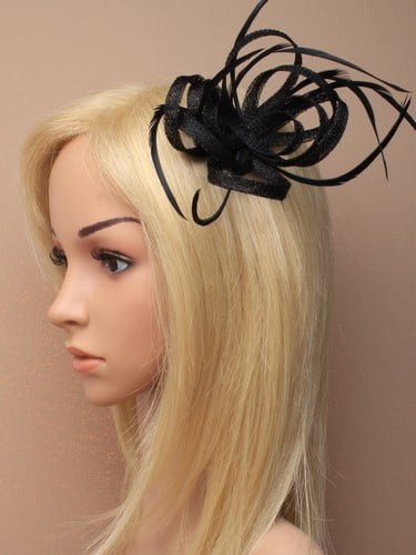 Black fascinator with loops and feathers on clip and pin.