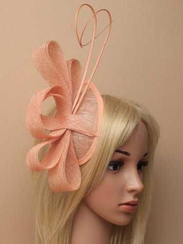 Nude cap fascinator with loops and ostrich quills on aliceband.