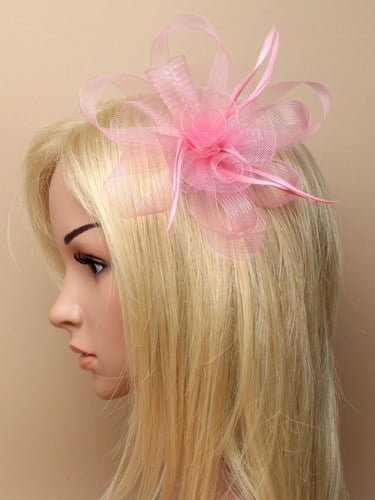 Rose pink looped net fascinator on clip and pin.