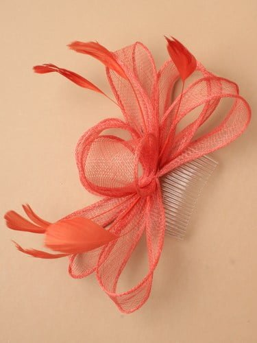 Coral fascinator with bows and feather tendrils on comb. (alt 1)