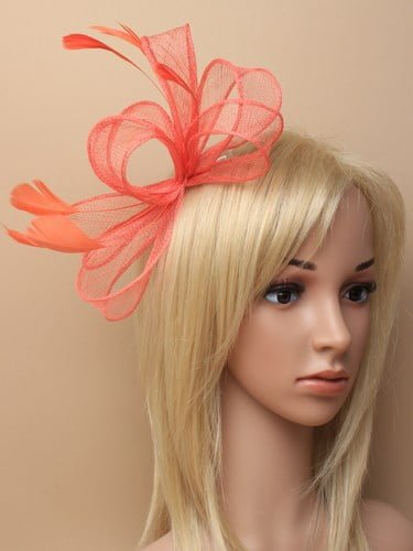Coral fascinator with bows and feather tendrils on comb. (alt 2)
