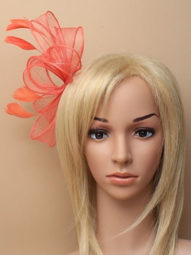 Coral fascinator with bows and feather tendrils on comb. (alt 3)