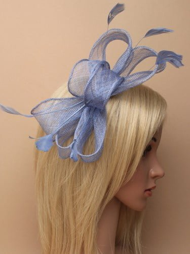 Blue fascinator with bows and feather tendrils on clear comb. (alt 1)