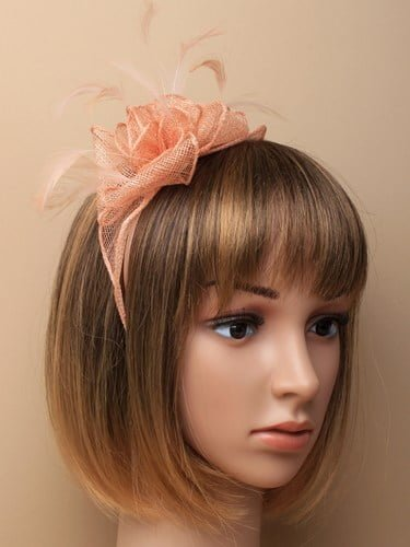 Nude flower shaped fascinator on aliceband.