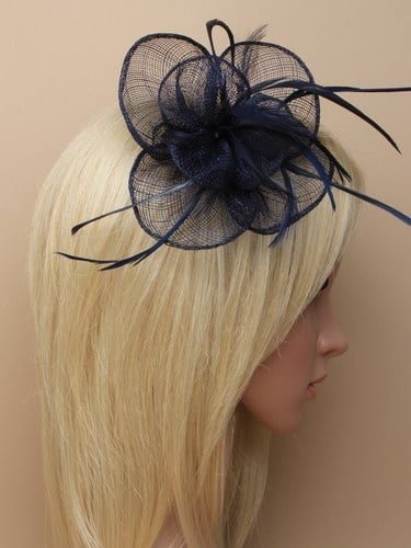 Navy blue fascinator with simulated flower and feather tendrils on clip and pin. (alt 3)