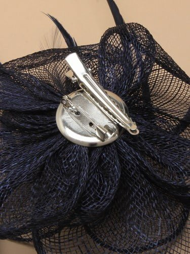 Navy blue fascinator with simulated flower and feather tendrils on clip and pin. (alt 4)