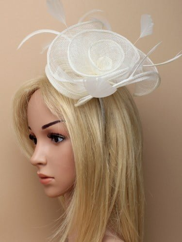 Large cream flower shaped fascinator with feather tendrils on aliceband.