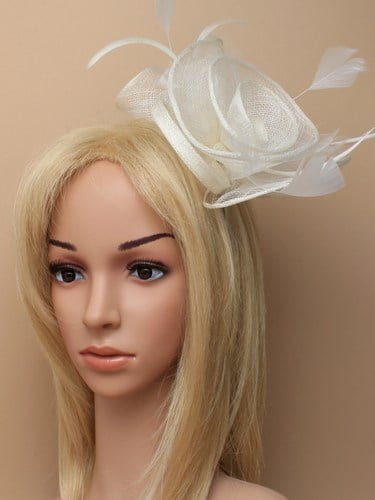 Large cream flower shaped fascinator with feather tendrils on aliceband.(alt 1)