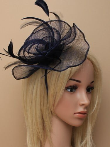 Navy blue fascinator with feathers on aliceband.