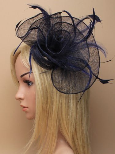 Navy blue flower shaped fascinator on clip.