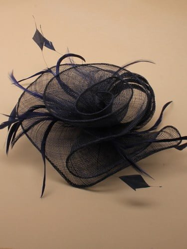 Navy blue flower shaped fascinator on clip. (alt 1)
