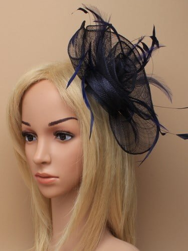 Navy blue flower shaped fascinator on clip. (alt 2)