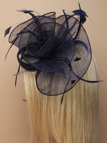 Navy blue flower shaped fascinator on clip. (alt 3)