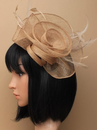 Large latte coloured flower shaped fascinator on clip.