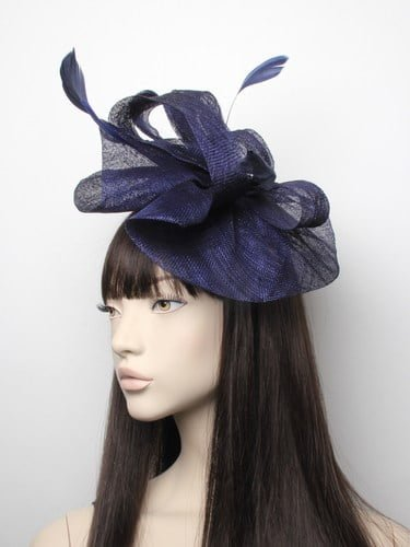 Large navy blue fascinator with feathers on aliceband.