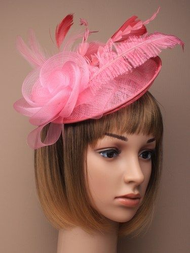 Large pink fascinator with flower and feathers on aliceband.