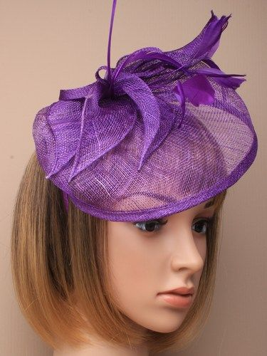 Large purple fascinator with feathers, leaves and bow on aliceband.