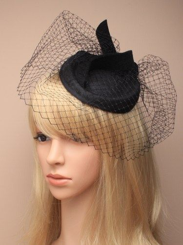 Black skull cap fascinator with netting and felt loop on a comb, elastic.