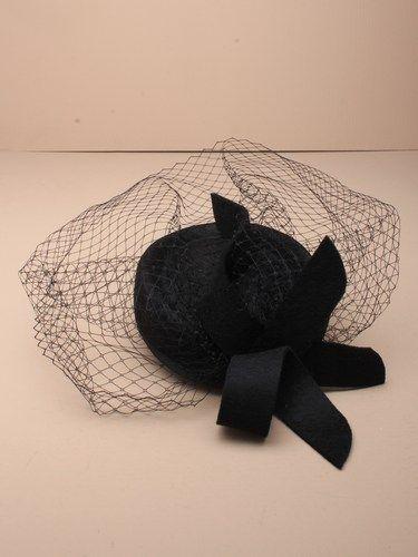 Black skull cap fascinator with netting and felt loop on a comb, elastic. (alt 1)