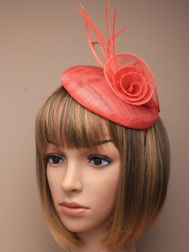 Coral fascinator with simulated flower and feathers on aliceband. (alt 3)