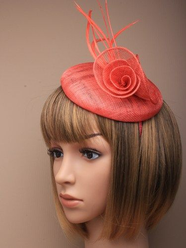 Coral fascinator with simulated flower and feathers on aliceband. (alt 1)