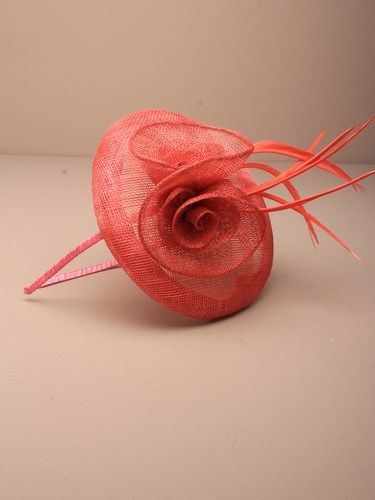 Coral fascinator with simulated flower and feathers on aliceband. (alt 2)