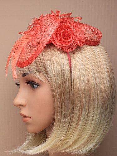 Coral fascinator with simulated roses and feathers on aliceband. (alt 1)