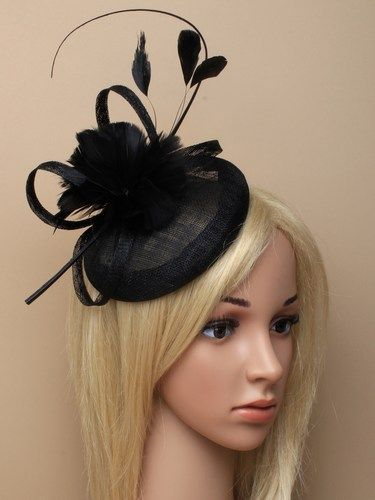 Black skull cap fascinator with feather flowers, bow and quill on aliceband.
