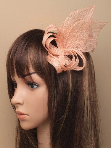 Nude looped fascinator with feathers on comb.