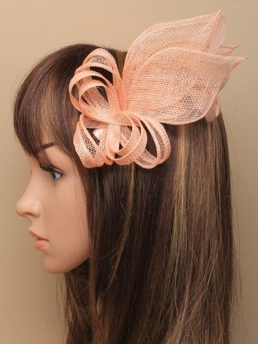 Nude looped fascinator with feathers on comb. (alt 1)