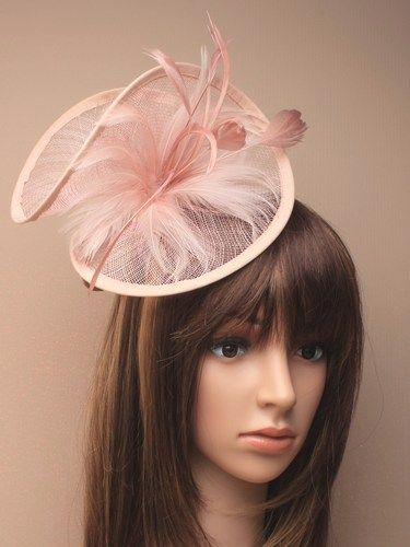 Large twisted dusky pink fascinator with feathers on aliceband.