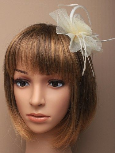 Cream fascinator with simulated flower and feathers on aliceband. (alt 2)