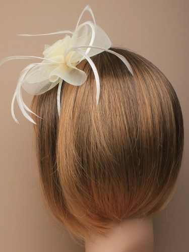 Cream fascinator with simulated flower and feathers on aliceband. (alt 1)