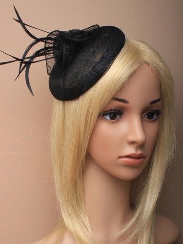 Black beret cap fascinator with flowers and feathers on an aliceband.