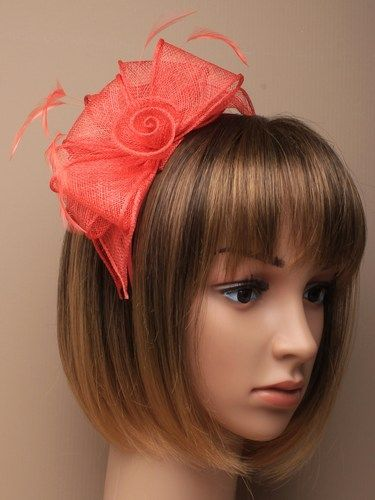 Coral fascinator with loops and feathers on aliceband.