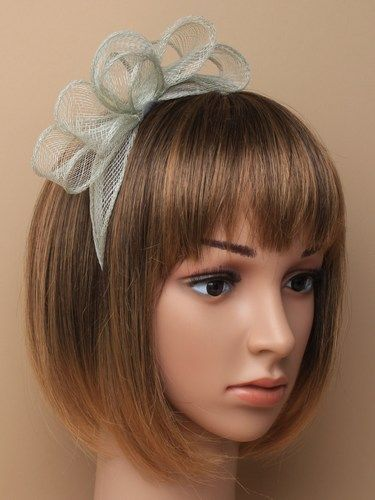 Pale sage green fascinator with bows on aliceband.