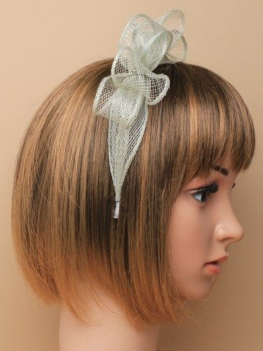Pale sage green fascinator with bows on aliceband. (alt 1)