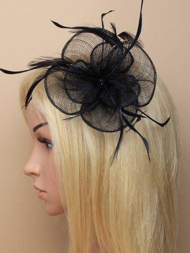 Black flower shaped fascinator with feathers on clip and pin.