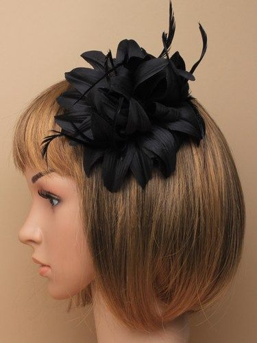 Black fabric fascinator with feathers on clip and pin.
