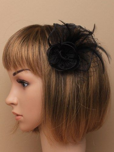 Black fascinator with flower and feathers on clip and pin.