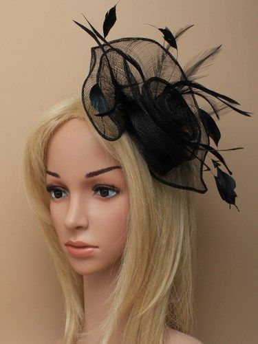 Black fascinator with loops, swirls and feathers on clip. (alt 3)