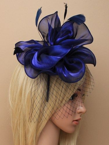 Navy fascinator with netting, feathers on aliceband 1