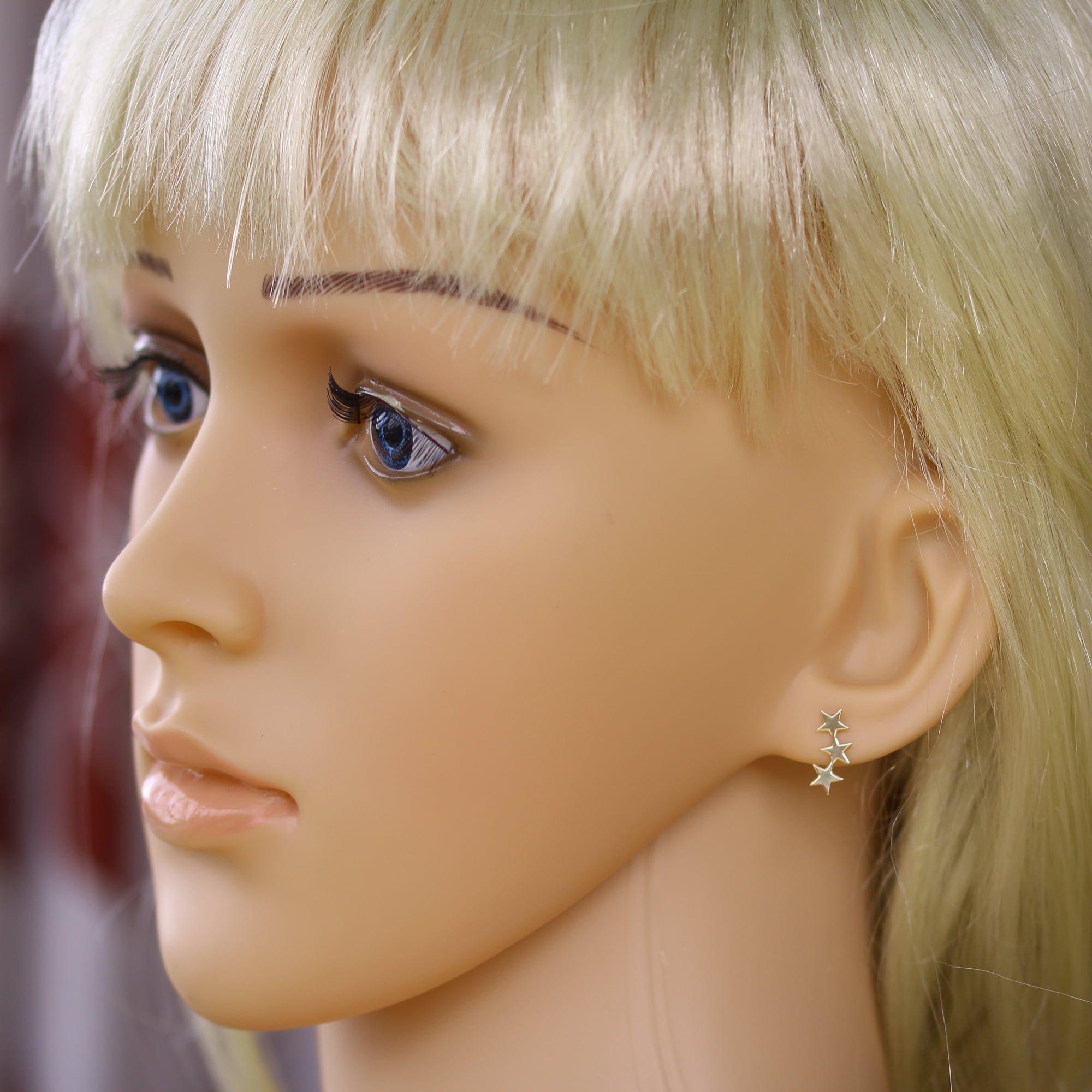 9ct gold cascading star earrings on model