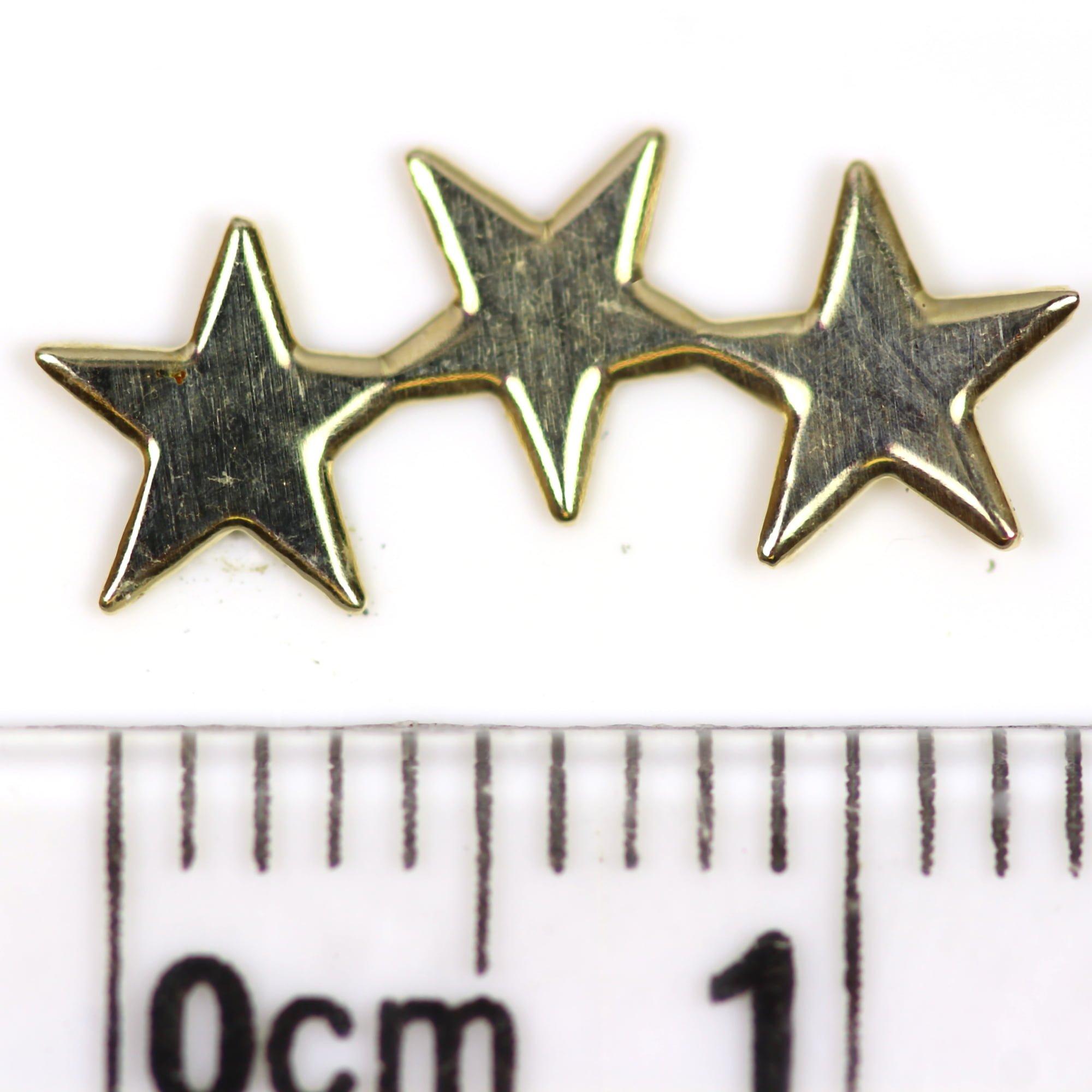 9ct gold cascading star earrings ruler