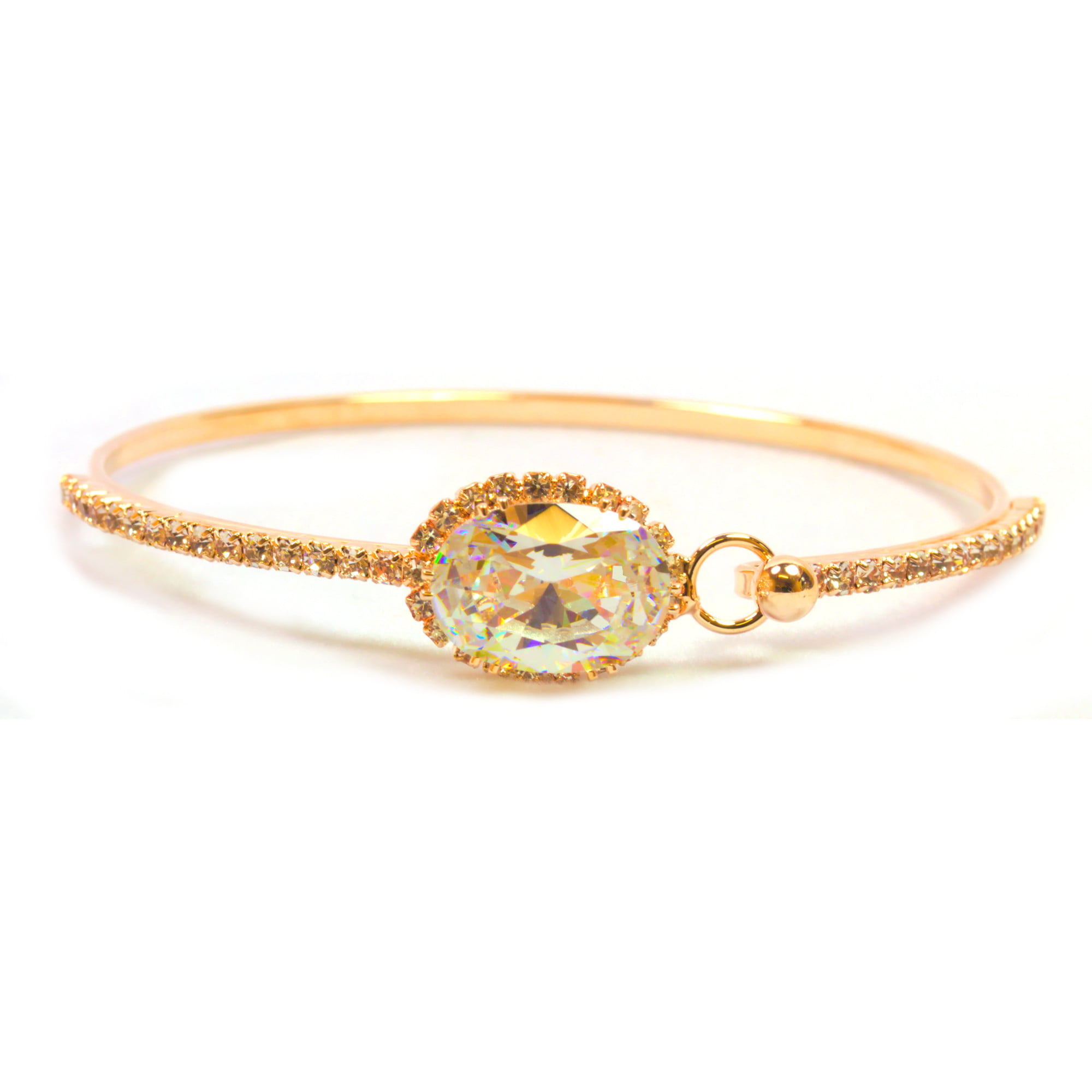 Rose gold plated bangle with large crystal stone.