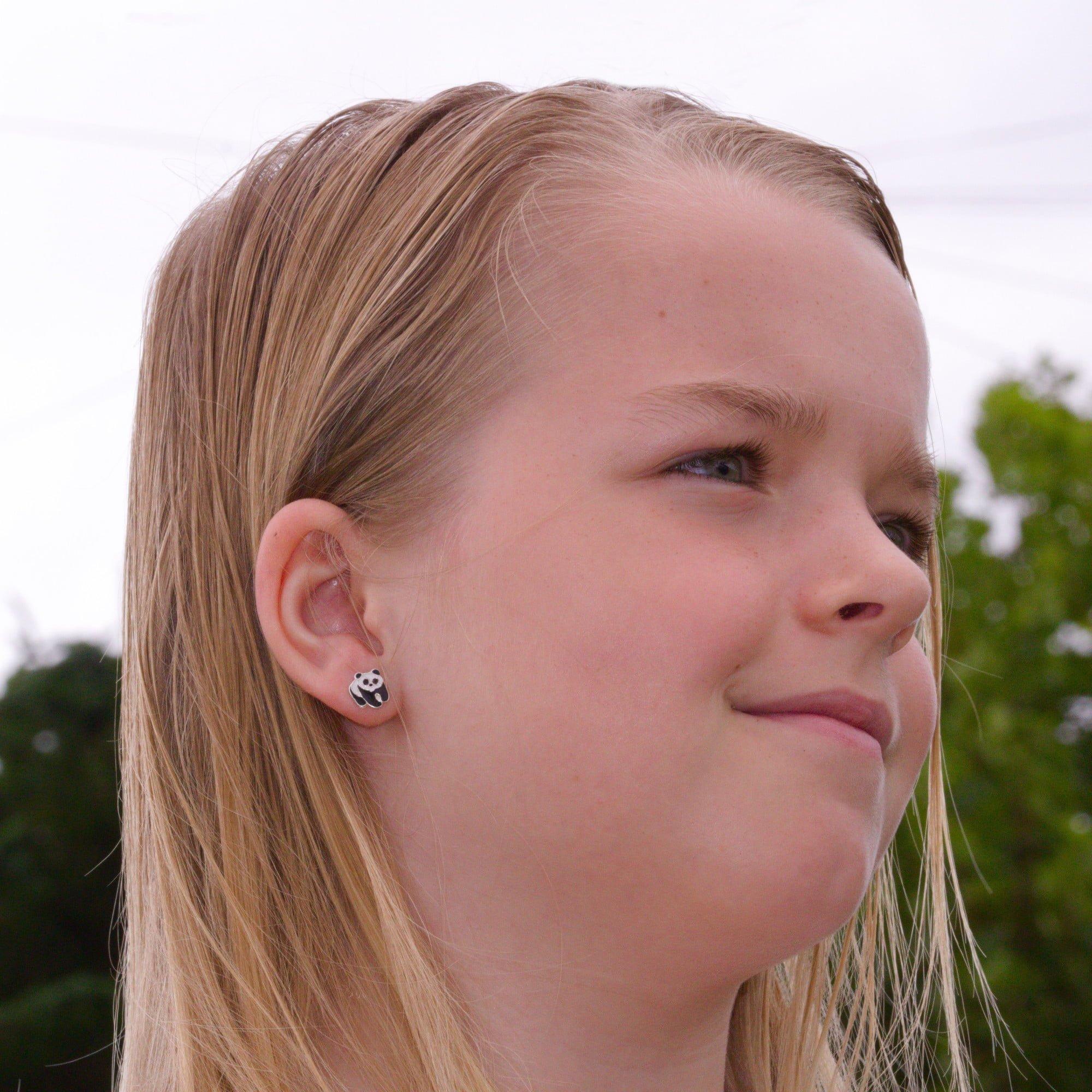 Panda earrings in sterling silver on model