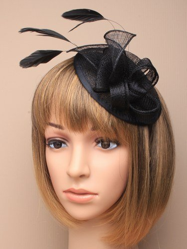 Black hessian hatinator with loops and feather tendrils. Fascinator set on  an alice hair band a8abc38bedb